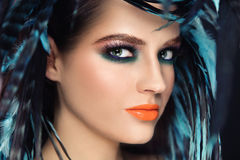 Exotic beauty. Close-up portrait of young beautiful woman with bright fancy make-up, selective focus Stock Image
