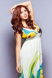 Exotic beauty in long sleeveless dress. In relaxed and calm mood Royalty Free Stock Image