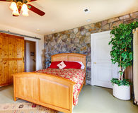 Exotic bedroom interior in countryside house Stock Photos