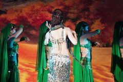Exotic belly dance with snake. Portrait of a beautiful woman performing exotic belly dance with a snake. This is part of the signature nightly performance hold Stock Photo