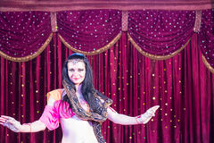 Exotic Belly Dancer with Large Snake on Stage Stock Photo