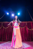 Exotic Belly Dancer Standing on Stage with Snake Royalty Free Stock Image