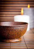 Exotic Bowl and Candles. An exotic Asian style wooden bowl on bamboo with candles Stock Photo