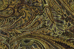 An exotic brown color pattern weaved fabric. As textural background Royalty Free Stock Photos