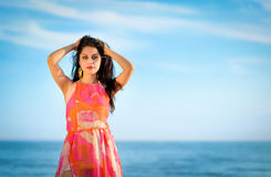 Exotic brunette on the summer beach Stock Photography