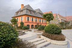 Exotic buildings at Euroean-style town in cloudy winter afternoo Stock Photography