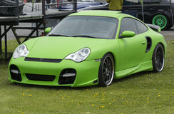 Exotic car. Picture of exotic green porche car on the grass Stock Photos