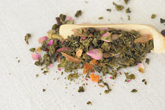 Chinese tea with rose buds Stock Images