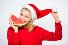 Exotic christmas concept. Christmas girl eat watermelon. Exotic winter holiday. Celebrate new year summer. Girl wear. Santa hat eat slice watermelon white stock photos