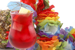 Exotic Cocktail. Cold refreshing cocktain and a colorful garland Royalty Free Stock Photos