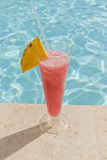 Exotic cocktail near swimming pool Royalty Free Stock Photo