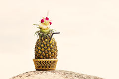 Exotic cocktail in a pineapple on a beach Royalty Free Stock Images