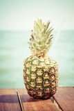 Exotic cocktail in the pineapple. Sea pier. Concept of luxury va Royalty Free Stock Image