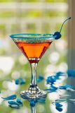 Exotic cocktail with rose petals royalty free stock image