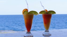 Exotic Cocktails on the Bar Counter on the Background of the Red Sea. Glass with Tropical Long drink with Fresh Red strawberry mousse and freshly squeezed stock footage