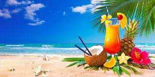 Exotic cocktails served on the beach royalty free stock photography