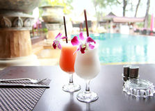 Exotic cocktails on table Stock Images