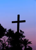 Exotic cross. Silhouettes of christian cross and palm trees in the sunset, in Palma De Mallorca Stock Images
