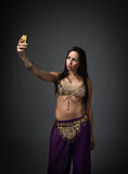Exotic dancer taking selfie Royalty Free Stock Photos