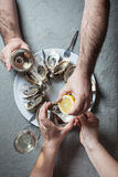 Exotic dish - oysters with wine Royalty Free Stock Photos