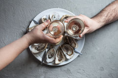 Exotic dish - oysters with wine Stock Images