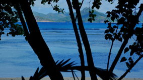 Exotic dream - Beach on island La Digue in Seychelles. Blue lagoon in La Digue, Seychelles with view to Praslin stock video footage
