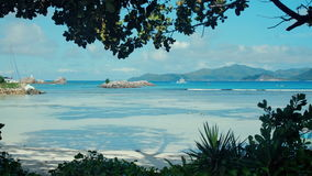 Exotic dream - Beach on island La Digue in Seychelles. Blue lagoon in La Digue, Seychelles with view to Praslin stock footage