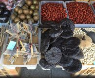 Exotic dried vegetables and animals in a market stall. A range of dried vegetables, nuts and animals for sale in a market stall. These include berries, sea Royalty Free Stock Image