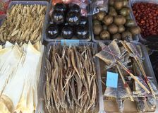 Exotic dried vegetables and animals in a market stall. A range of dried vegetables, nuts and animals for sale in a market stall. These include berries, sea stock image
