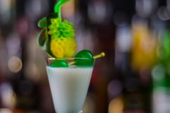 Exotic drink based on Malibu rum and other ingredients, cocktail. Prepared by the bartender, decorated drink Stock Photos