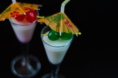 Exotic drink based on Malibu rum and other ingredients, cocktail. Prepared by the bartender, decorated drink Stock Images