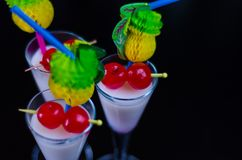 Exotic drink based on Malibu rum and other ingredients, cocktail. Prepared by the bartender, decorated drink Royalty Free Stock Photo
