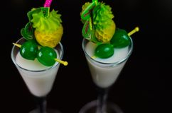 Exotic drink based on Malibu rum and other ingredients, cocktail. Prepared by the bartender, decorated drink Stock Image