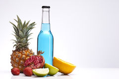 Exotic drink in bottle with fruits Royalty Free Stock Photography