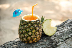 Exotic drink in a pineapple Royalty Free Stock Image