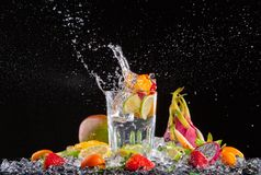 Exotic drink with splash on black background Royalty Free Stock Image
