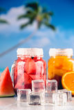 Exotic drinks with fruits in jar Royalty Free Stock Images