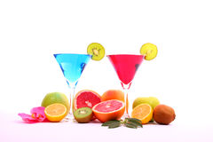 Exotic drinks in martini glass. Exotic drinks and exotic fruits Royalty Free Stock Photo