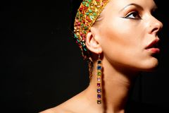 Exotic female. Gorgeous woman with exotic accessories on black background Stock Photo