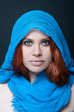 Exotic female model with headscarf. And stunning makeup looking at the camera Royalty Free Stock Image