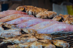 Exotic fish being grilled red and brown in Thailand Royalty Free Stock Image