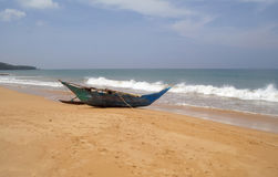 Exotic fisherman boat on beach . Royalty Free Stock Image