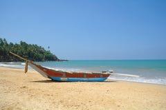 Exotic fisherman boat on beach near the ocean Royalty Free Stock Photo