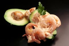 Diet food: Avocado and shrimps stock photo