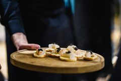 Exotic food is being degustated at a luxury corporate dinner event stock images