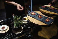 Exotic food is being degustated at a luxury corporate dinner event stock photos