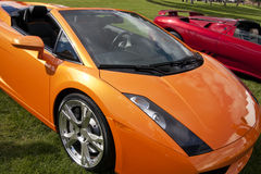 Exotic Foreign Sports Cars. Very colorful new expensive European luxury sports cars royalty free stock photos