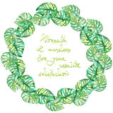 Exotic frame border (wreath) with monstera green leaves painted in watercolor for greeting card, decoration postcard or invitation Royalty Free Stock Image