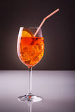Exotic fresh drink. Glass of exotic drink, wine-based; mixed drink with aperol, prossecco wine, soda, ice cubes on black background stock photography