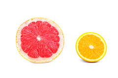 Exotic, fresh and juicy grapefruit slice and ripe, citrus, tasty, bright yellow lemon slice, isolated on a white background. Stock Image
